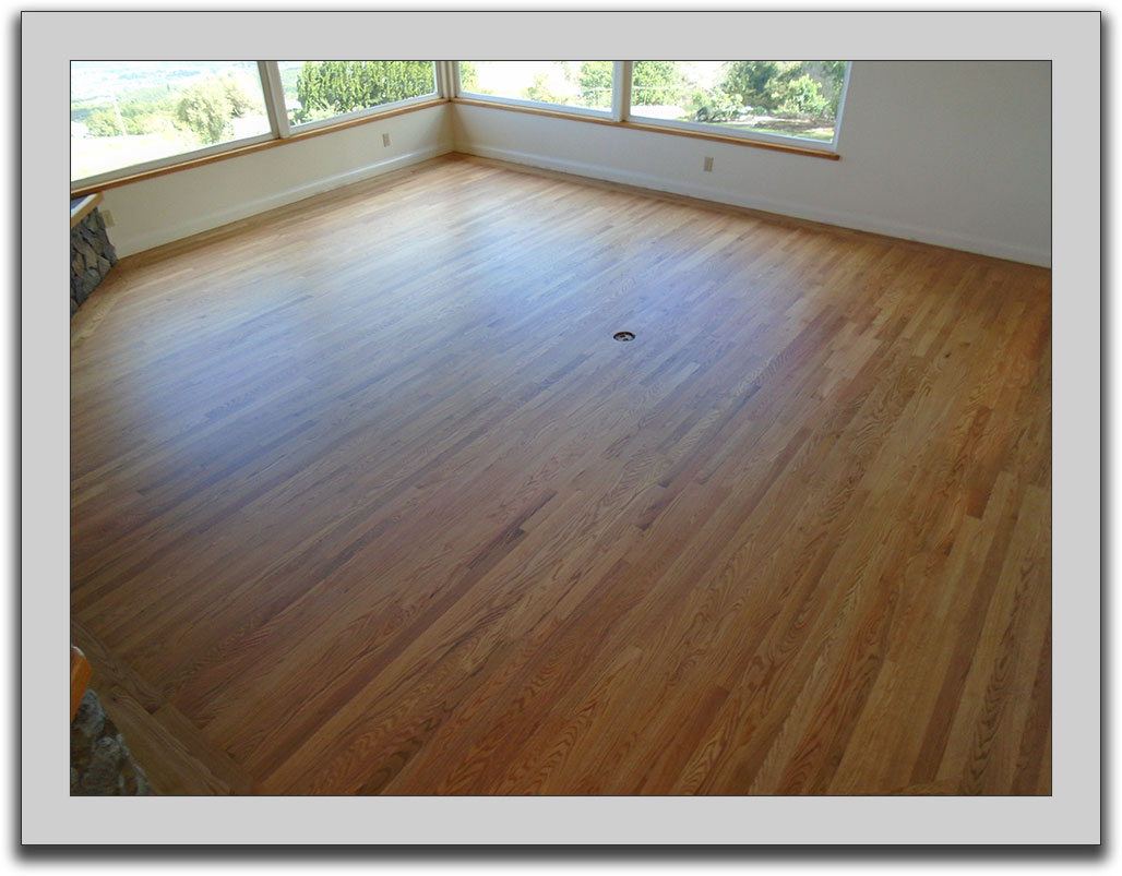 Refinished wood floor in a great room.